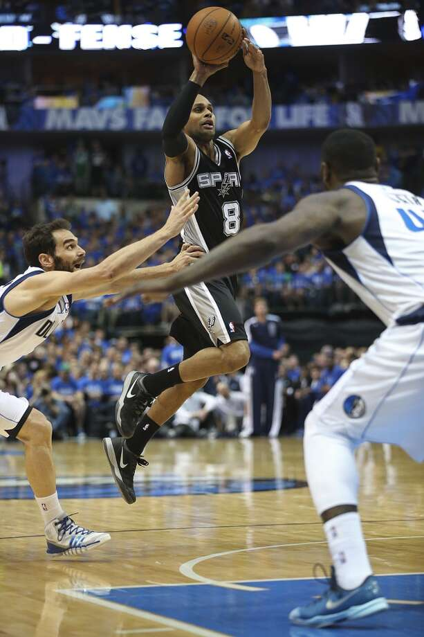 San Antonio Spurs' Patty Mills shoots between Dallas Mavericks' Jose Calderon and DeJuan Blair during the second half of game six in the first round of the Western Conference Playoffs at the American Airlines Center in Dallas, Friday, May 2, 2014. The Mavericks won 113-111 to even the series at 3-3. Photo: Jerry Lara, San Antonio Express-News