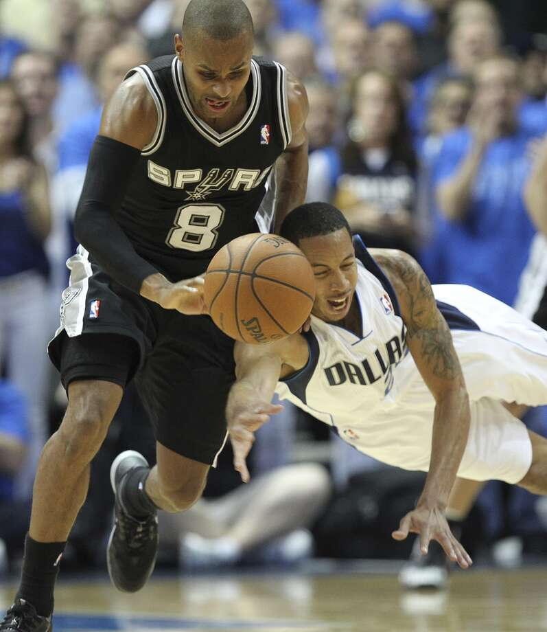 San Antonio Spurs' Patty Mills steals the ball from Dallas Mavericks' Devin Harris during the second half of game four in the first round of the Western Conference Playoffs at the American Airlines Center in Dallas, Monday, April 28, 2014. The Spurs won 93-89 to tie the series 2-2. Photo: Jerry Lara, San Antonio Express-News