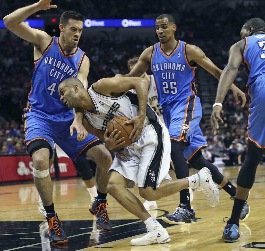 Tony Parker sneaks through the Thunder defense as the San Antonio Spurs play the Oklahoma City Thunder in game 2 of the Western Conference Finals at the AT&T Center on May 21, 2014. Photo: Tom Reel, San Antonio Express-News