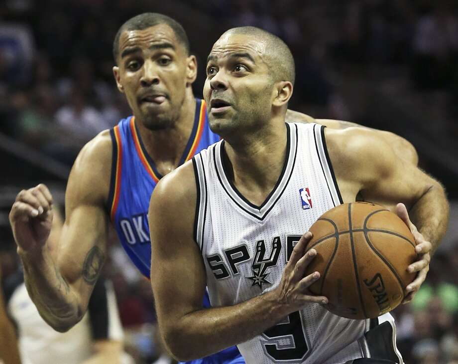 Tony Parker beats Thabo Sefolosha to the bucket as the San Antonio Spurs play the Oklahoma City Thunder in game 2 of the Western Conference Finals at the AT&T Center on May 21, 2014. Photo: Tom Reel, San Antonio Express-News