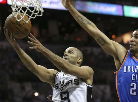 Tony Parker beats  Thabo Sefolosha to the hoop as the San Antonio Spurs play the Oklahoma City Thunder in game 2 of the Western Conference Finals at the AT&T Center on May 21, 2014. Photo: Tom Reel, San Antonio Express-News