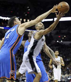San Antonio Spurs' Tony Parker shoots around Oklahoma City Thunder's Nick Collison during second half action of Game 1 in the Western Conference Finals Monday May 19, 2014 at the AT&T Center. The Spurs won 122-105. Photo: Edward A. Ornelas, San Antonio Express-News