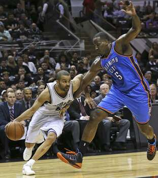 Tony Parker turns the corner on Kendrick Perkins  as the Spurs play the Thunder in the opener of the NBA Western Conference finals at the AT&T Center on May 19, 2014. Photo: Tom Reel, San Antonio Express-News