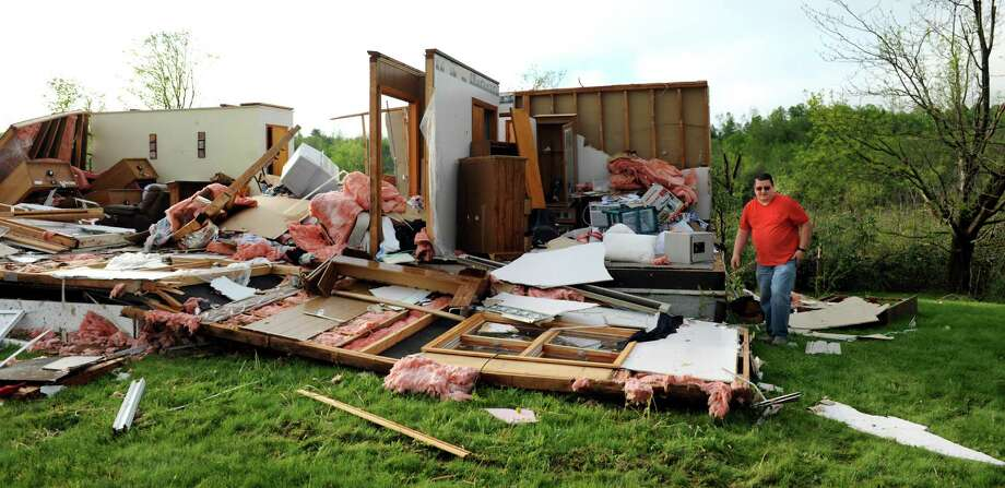 Jeff Bivins, son of home owner Margaret Krylowicz, gathers a few things from her house that was destroyed from a fast-moving storm that swept across Route 20 on Thursday, May 22, 2014, in Duanesburg, N.Y. (Cindy Schultz / Times Union) Photo: Cindy Schultz