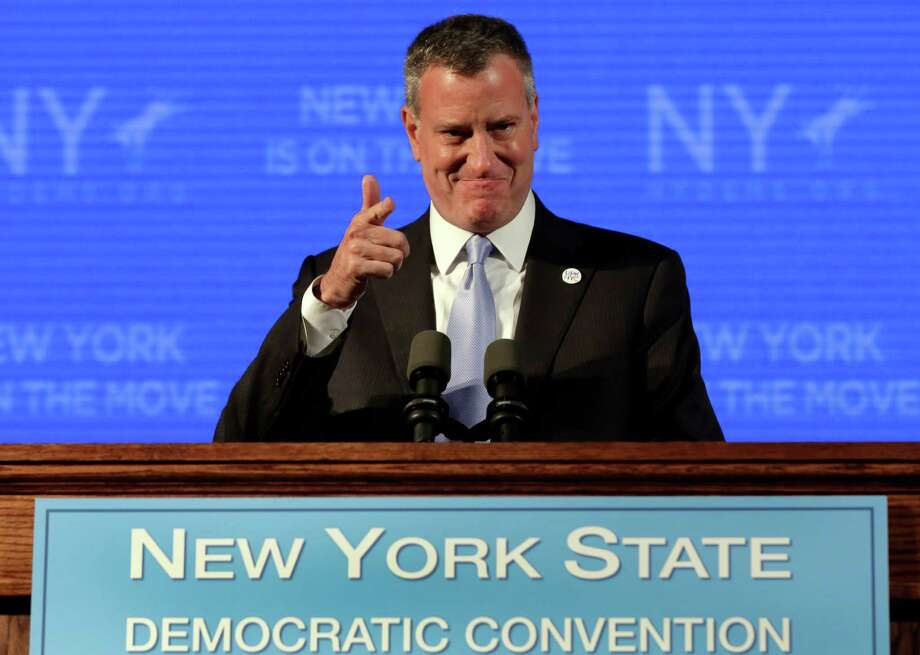 New York Mayor Bill de Blasio nominates New York Gov. Andrew Cuomo for re-election, at the state's Democratic Convention, in Melville, N.Y., Thursday, May 22, 2014. Gov. Andrew Cuomo launched his bid for a second term Thursday with sharp criticism of Republicans and resounding support from liberal New York City Mayor Bill de Blasio. (AP Photo/Richard Drew) ORG XMIT: NYRD112 Photo: Richard Drew / AP