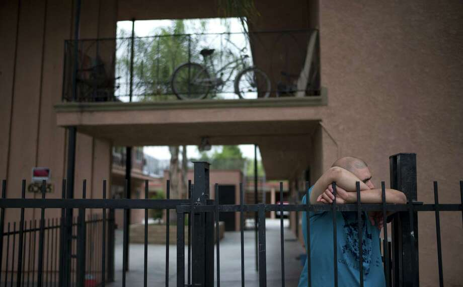 A manager at an apartment building in Bell Gardens, Calif., where suspect Isidro Garcia lived discusses the case with a neighbor. Photo: Jae C. Hong / Associated Press / AP