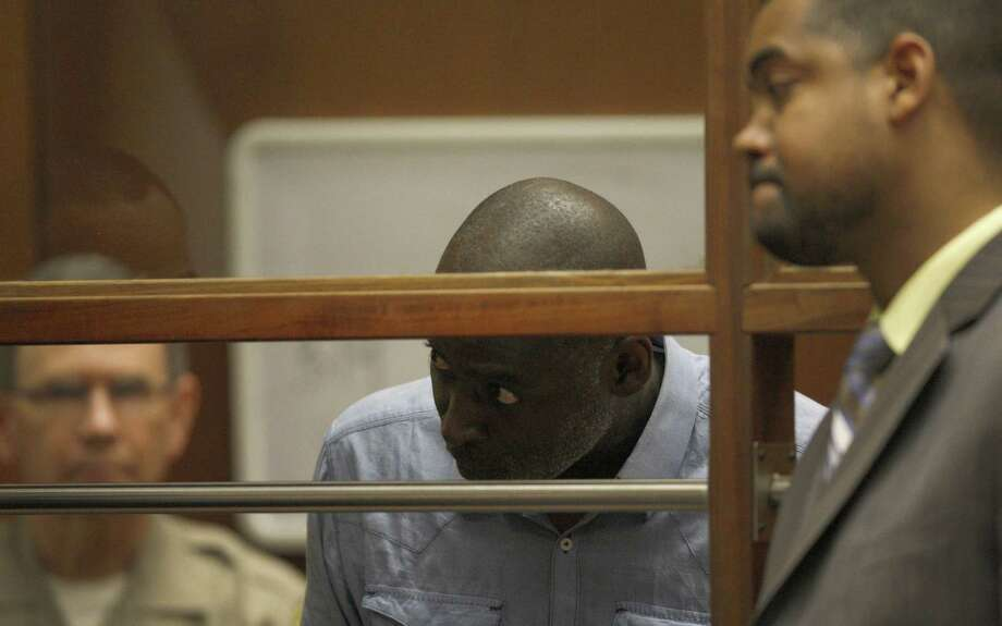 Actor Michael Jace (left) talks to attorney Peter Carr during his first appearance in court to face a homicide charge in relation to the shooting death of his wife in Los Angeles. Photo: David McNew / AFP / Getty Images / 2014 AFP