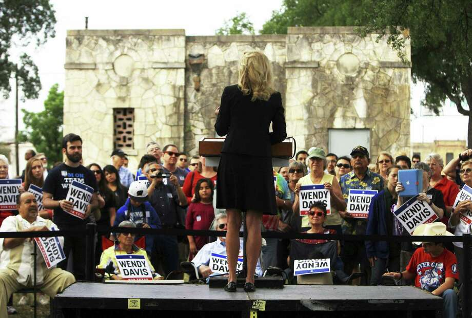 "Sen. Wendy Davis' gubernatorial campaign said the poster is an ""offensive"" attempt by Greg Abbott ""to demean Wendy Davis and women across Texas."" Photo: Jennifer Whitney / New York Times / NYTNS"