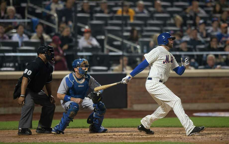 NEW YORK, NY - MAY 22:  Pitcher Jonathon Niese #49 of the New York Mets hits an RBI double in the fifth inning against the Los Angeles Dodgers at Citi Field on May 22, 2014 in the Queens borough of New York City.  (Photo by Ron Antonelli/Getty Images) ORG XMIT: 477583571 Photo: Ron Antonelli / 2014 Getty Images