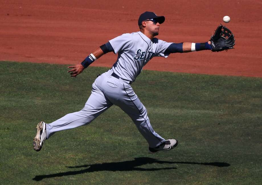 """Franklin Gutierrez Fly Swatter NightThe late, great Dave Niehaus gave former M's outfielder Franklin Gutierrez the nickname """"Death to Flying Things,"""" thanks to Guti's clutch defense in center. The nickname understandably was a hit. On May 19, 2011 -- six months after Niehaus' death -- the Mariners honored the Hall of Fame broadcaster by handing out free Gutierrez fly swatters. They were exactly what you might think; check out this photo. Photo: Brad Mangin, Getty Images"""