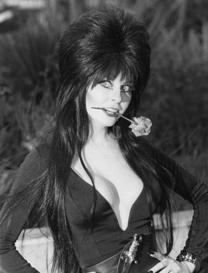 Fright Night  Friday, July 13, 1990, was an interesting night at the Kingdome. The Mariners saluted Friday the 13th with Fright Night, a themed game celebrating all things eerie and creepy. Elvira (portrayed by acrtress Cassandra Peterson, pictured) threw out the first pitch and mingled with fans. But perhaps the scariest part of that evening was the final score: a 13-7 loss to the Cleveland Indians. Photo: Richard Blanshard, Getty Images
