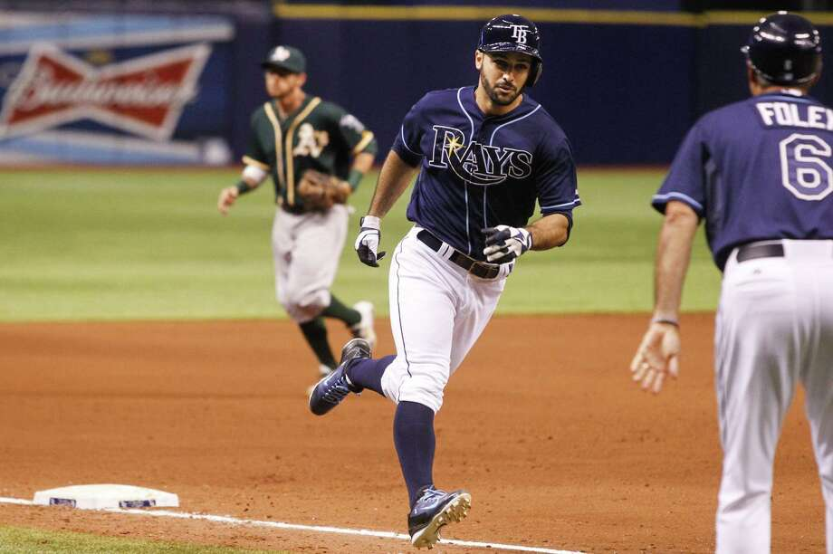 Tampa Bay's Sean Rodriguez rounds third after his game-winning homer in the 11th against Oakland. Photo: Will Vragovic / McClatchy-Tribune News Service / Tampa Bay Times