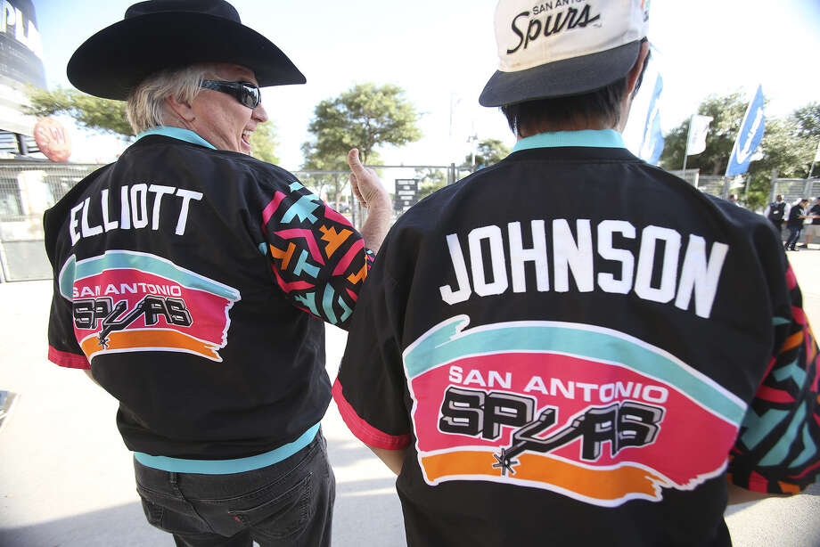 Joe Calvey (left) and son Joey Calvey sport warm-up jackets from the era of Sean Elliott and Avery Johnson. Photo: Photos By Tom Reel / San Antonio Express-News