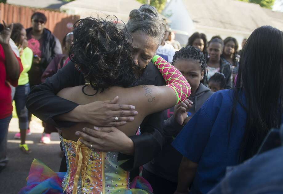 "Tamarea Steward, 19, hugs Katherine Owens, Tonquinisha McKinley's grandmother during a gathering in her remembrance, Thursday, May 22, 2014 on Cronk near Bond in Saginaw, Mich. Tonquinisha ""NeNe"" McKinley, 17, was killed during an unofficial Saginaw High pre-prom party outside the Florence Event Hall on the city's southwest side, May 23, 2013. (AP Photo/The Saginaw News, Tim Goessman) Photo: Tim Goessman, Associated Press"