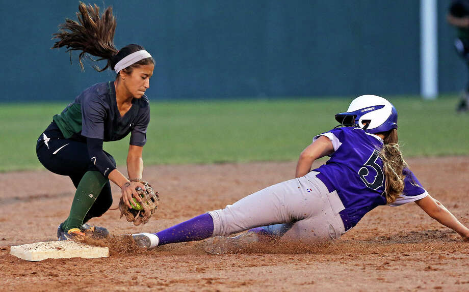 Lady Rattler baserunner Madie Bumgardner steals second base safely as shortstop Kristal Salinas can't get the put out throw on her in time in the second inning as Southwest plays San Marcos in game 1 of a 5A regional final softball series at NEISD Complex  on May 22, 2014. Photo: Tom Reel, San Antonio Express-News
