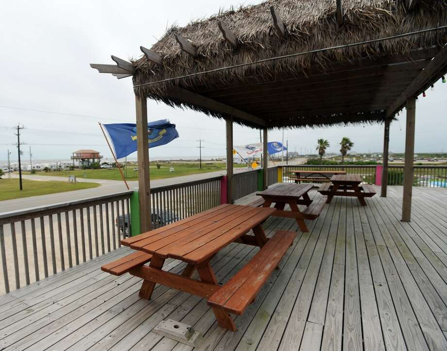 Covered picnic tables look across Texas 87 and into the gulf from the upper deck of FantaSea BBQ and Grill. Crystal Beach and the Bolivar Peninsula is home to several quality restaurants and bars. Photo taken Saturday 5/10/14 Jake Daniels/@JakeD_in_SETX