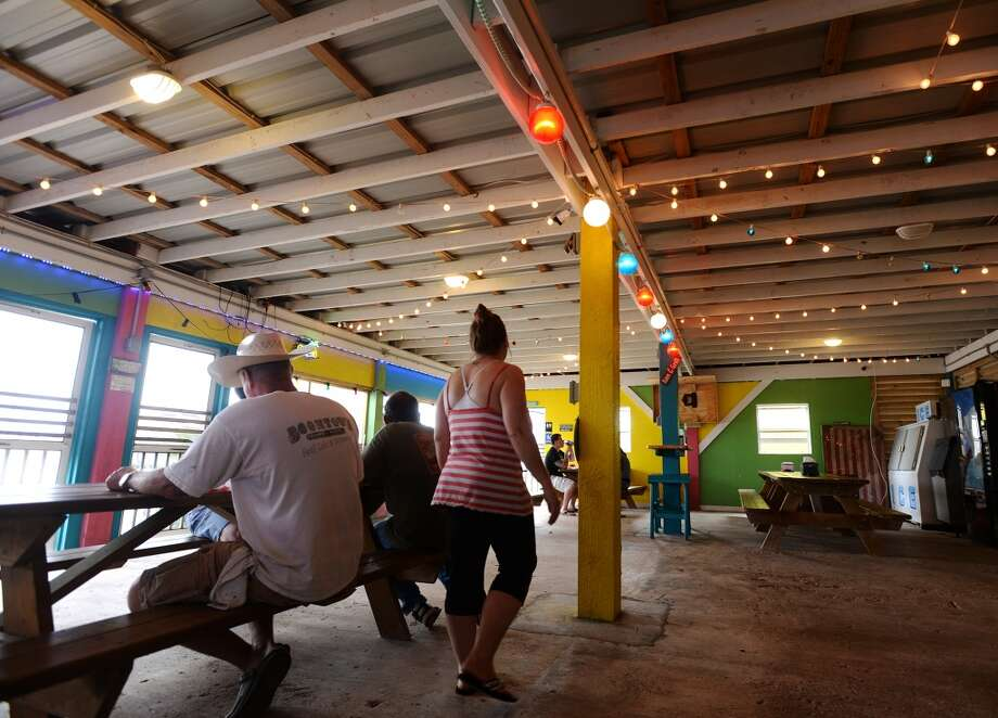 The airy interior of FantaSea BBQ and Grill is colorfully decorated and strung with lights. Crystal Beach and the Bolivar Peninsula is home to several quality restaurants and bars. Photo taken Saturday 5/10/14 Jake Daniels/@JakeD_in_SETX