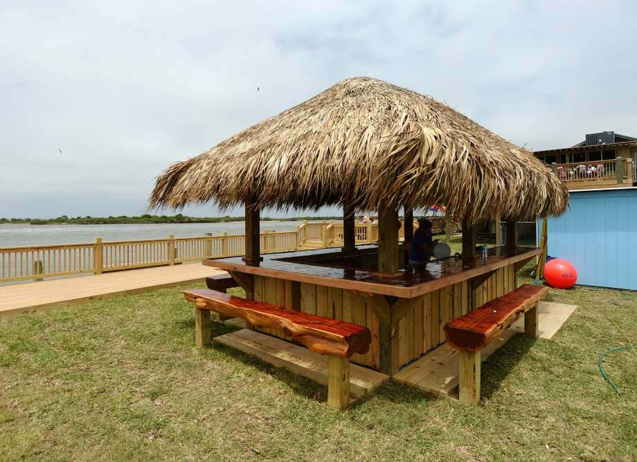 Pictured is the Down Under Bar and Grill's newly opened outdoor bar on Saturday afternoon. Crystal Beach and the Bolivar Peninsula is home to several quality restaurants and bars. Photo taken Saturday 5/10/14 Jake Daniels/@JakeD_in_SETX
