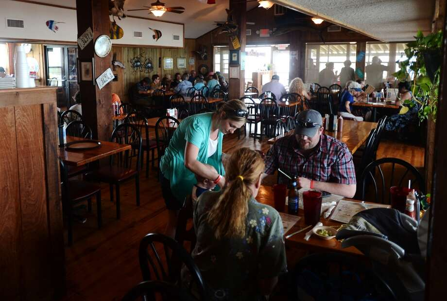 Diners settle in for a meal at the Stingaree Marina Restaurant on Saturday afternoon. Crystal Beach and the Bolivar Peninsula is home to several quality restaurants and bars. Photo taken Saturday 5/10/14 Jake Daniels/@JakeD_in_SETX