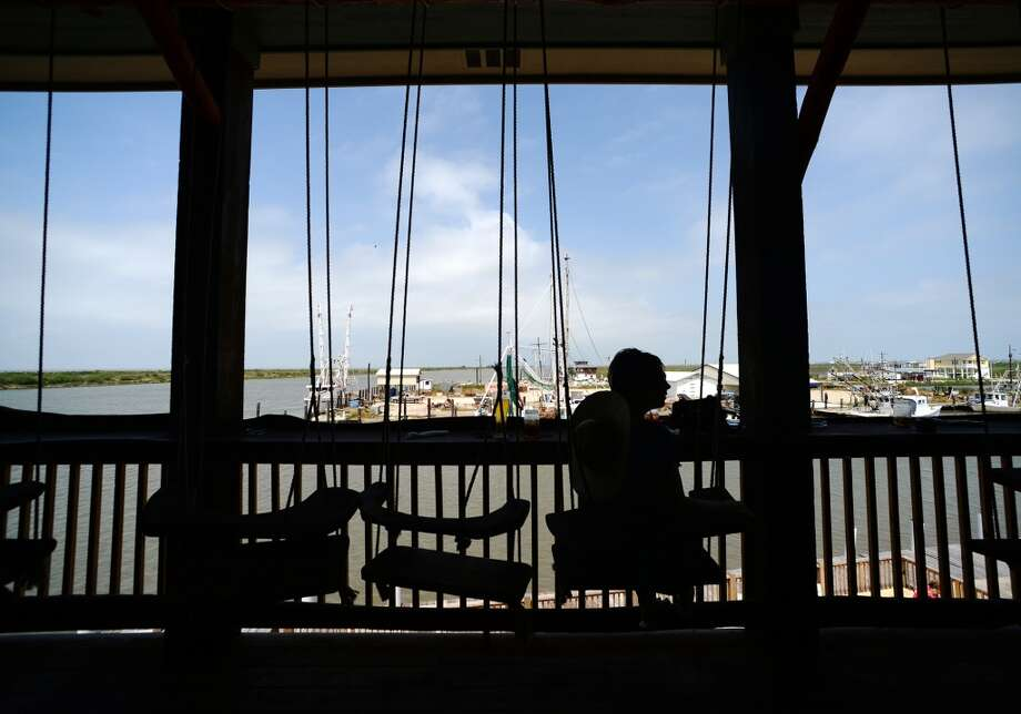 "Sheena McCrary enjoys a drink at the ""swing bar"" at Steve's Landing on Saturday afternoon. Crystal Beach and the Bolivar Peninsula is home to several quality restaurants and bars. Photo taken Saturday 5/10/14 Jake Daniels/@JakeD_in_SETX"