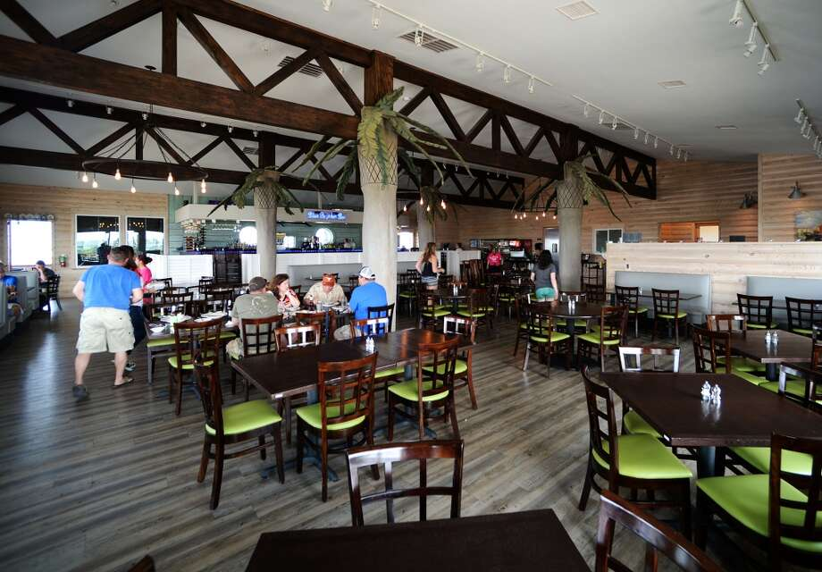 Large windows let in an abundance of natural light at Steve's Landing on Saturday afternoon. Crystal Beach and the Bolivar Peninsula is home to several quality restaurants and bars. Photo taken Saturday 5/10/14 Jake Daniels/@JakeD_in_SETX