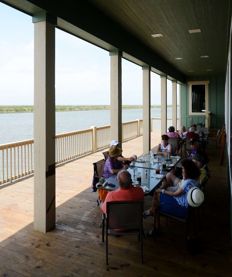 Diners enjoy their meals on the back deck of Steve's Landing on Saturday afternoon. Crystal Beach and the Bolivar Peninsula is home to several quality restaurants and bars. Photo taken Saturday 5/10/14 Jake Daniels/@JakeD_in_SETX