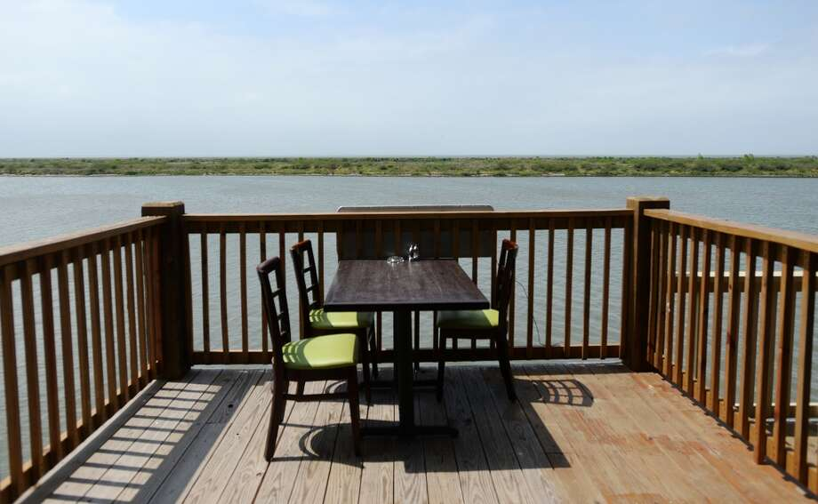 Pictured is an open table next to the water at Steve's Landing. Crystal Beach and the Bolivar Peninsula is home to several quality restaurants and bars. Photo taken Saturday 5/10/14 Jake Daniels/@JakeD_in_SETX
