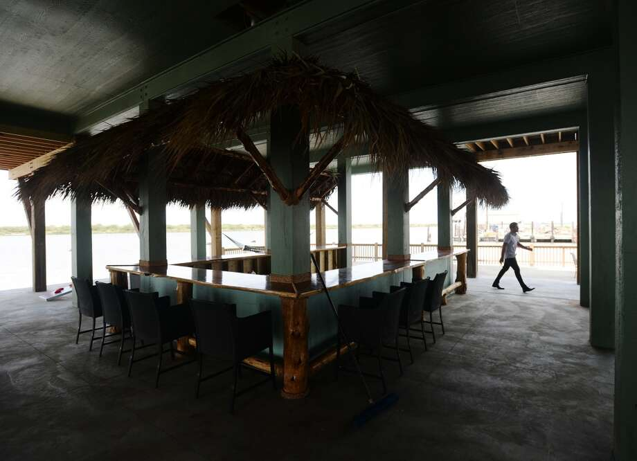 A man walks by the brand new open air bar beneath Steve's Landing on Saturday afternoon. Crystal Beach and the Bolivar Peninsula is home to several quality restaurants and bars. Photo taken Saturday 5/10/14 Jake Daniels/@JakeD_in_SETX