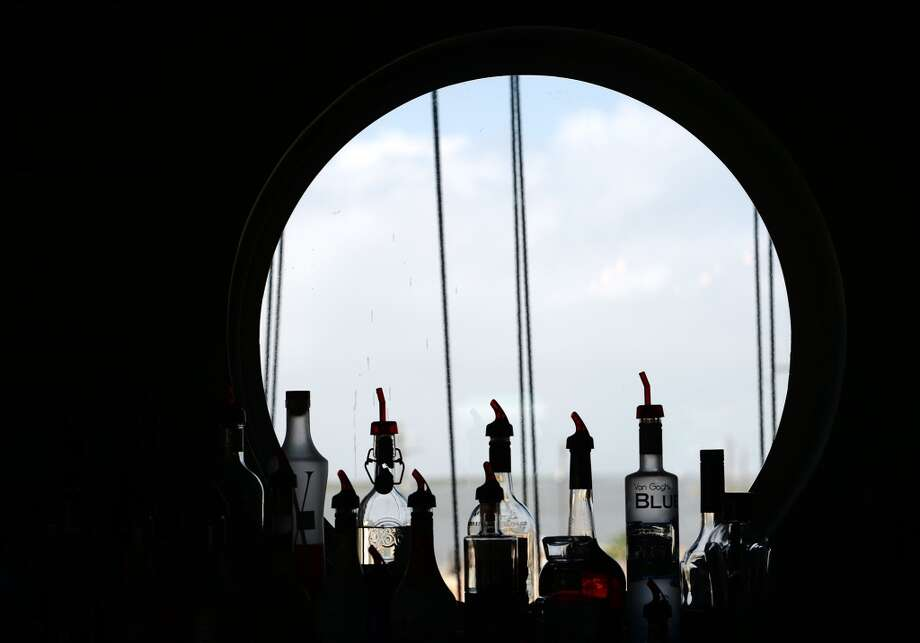 Liquor bottles are silhouetted against a window at Steve's Landing on Saturday afternoon. Crystal Beach and the Bolivar Peninsula is home to several quality restaurants and bars. Photo taken Saturday 5/10/14 Jake Daniels/@JakeD_in_SETX