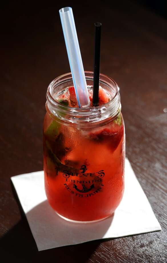 Pictured is the strawberry mojito from the Blue Dolphin Bar at Steve's Landing. Crystal Beach and the Bolivar Peninsula is home to several quality restaurants and bars. Photo taken Saturday 5/10/14 Jake Daniels/@JakeD_in_SETX