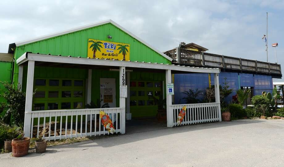 Pictured is the facade of the Tiki Beach Bar and Grill on Saturday afternoon. Crystal Beach and the Bolivar Peninsula is home to several quality restaurants and bars. Photo taken Saturday 5/10/14 Jake Daniels/@JakeD_in_SETX