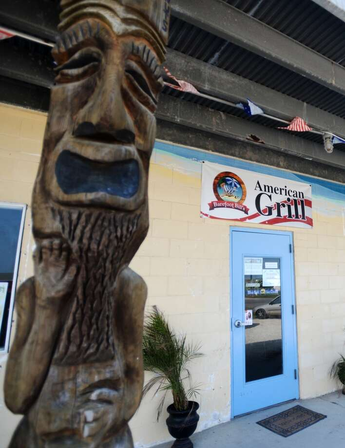 Pictured is the exterior of Barefoot Bill's American Grill on Saturday afternoon. Crystal Beach and the Bolivar Peninsula is home to several quality restaurants and bars. Photo taken Saturday 5/10/14 Jake Daniels/@JakeD_in_SETX