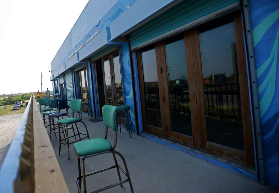 Doors lead out to balcony seating at the Bamboo Beach Bar, located above Barefoot Bill's American Grill. Crystal Beach and the Bolivar Peninsula is home to several quality restaurants and bars. Photo taken Saturday 5/10/14 Jake Daniels/@JakeD_in_SETX