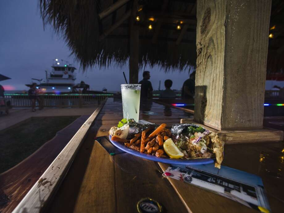 Pictured is a Stingarita and a plate of the Stingaree Marina Restaurant's soft shell crab tacos. Crystal Beach and the Bolivar Peninsula is home to several quality restaurants and bars. Photo taken Saturday 5/10/14 Jake Daniels/@JakeD_in_SETX