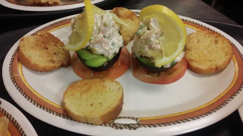 Pictured is the avocados stuffed with shrimp salad, available from Barefoot Bill's American Grill. Crystal Beach and the Bolivar Peninsula is home to several quality restaurants and bars. Contributed photo by Barefoot Bill's American Grill Photo: Jake Daniels, ©2014 The Beaumont Enterprise/Jake Daniels / ©2014 The Beaumont Enterprise/Jake Daniels