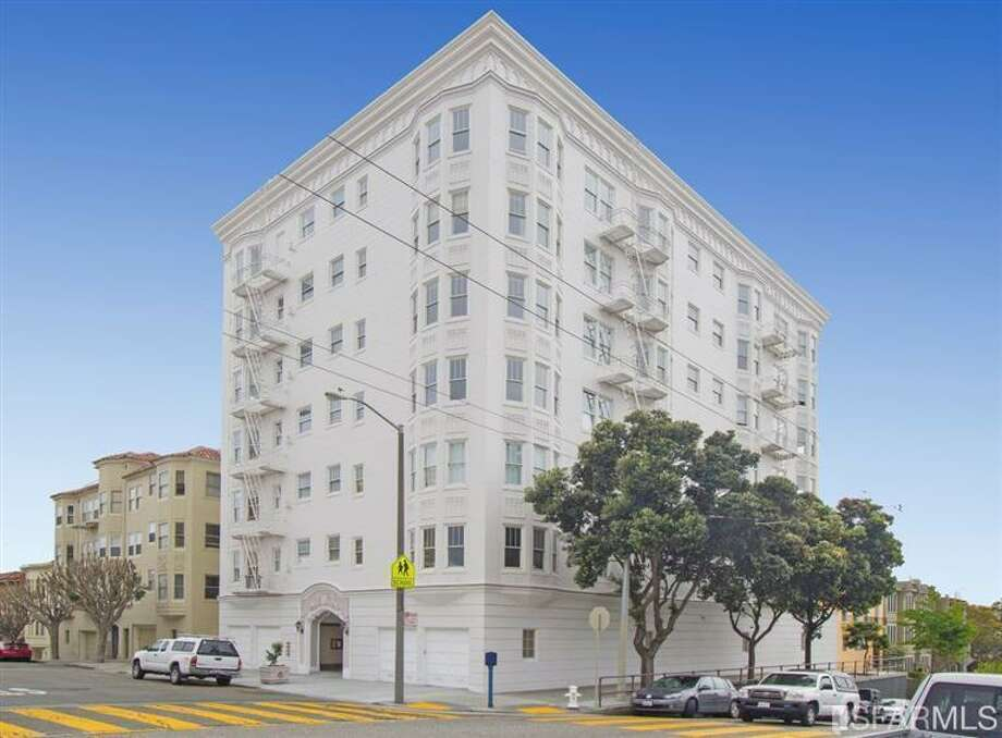 On the market for $16 million, this detached, seven-story apartment building is located right on Alamo Square. Photo: MLS