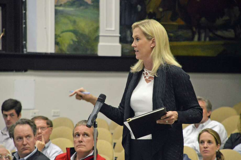 Jenny Schwartz, of Saddle Ridge Road in Darien, is helping lead opposition to the construction of a cell tower at the Ox Ridge Hunt Club. Jarret Liotta/For the Darien News Photo: Contributed Photo, Contributed / Darien News