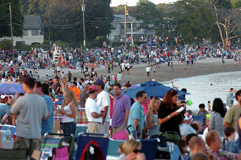 Some people have cited crowding at Compo Beach as a reason not to issue more parking permits for out-of-town residents. Here, a photo of what is usually the largest Compo crowd of the season for the July 4 fireworks a few years ago. Photo: File Photo / Fairfield Citizen