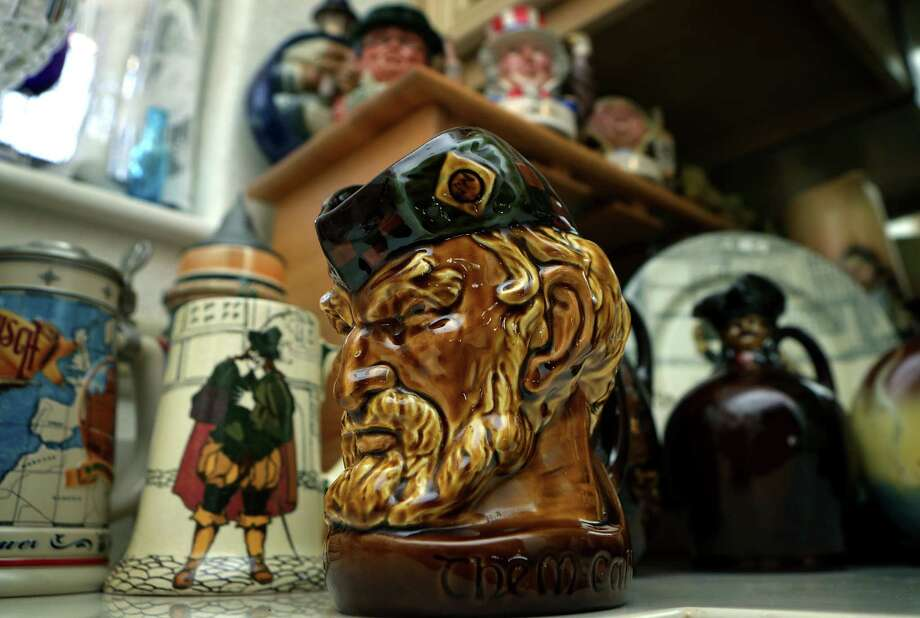 "An early piece of Doulton pottery called ""The McCallum"" is part of the collection in the home of Ann and George Berg. Photo: BOB OWEN, San Antonio Express-News / © 2012 San Antonio Express-News"