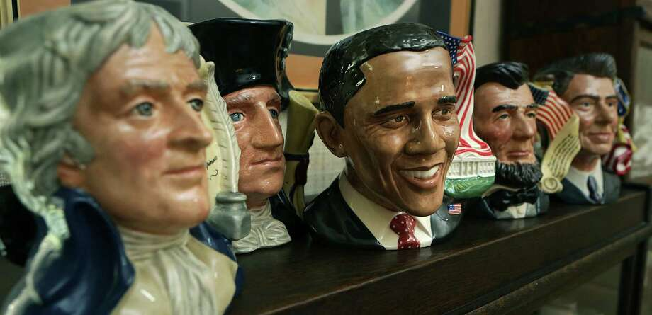 The Bergss collection of Doulton Pottery includes a set of the U.S. presidents including Thomas Jefferson, left to right, George Washington, Barack Obama, Abraham Lincoln and Ronald Reagan. Photo: BOB OWEN, San Antonio Express-News / © 2012 San Antonio Express-News