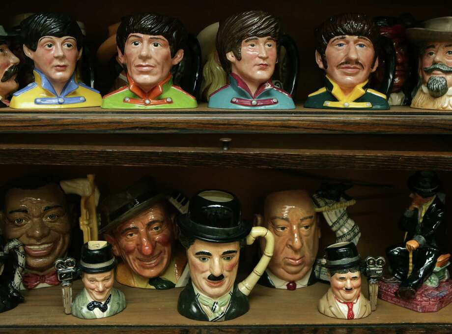 The Beatles, top, and other entertainers are represented in the Doulton Collection in the home of Ann and George Berg. Photo: BOB OWEN, San Antonio Express-News / © 2012 San Antonio Express-News