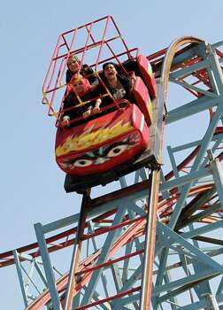 "Roller coasters have a universal appeal, Iraqis hold on ge at a theme park during the Muslim holiday of Eid al-Adha or ""Feast of the Sacrifice"" last October inl Baghdad.  Photo: AHMAD AL-RUBAYE, Getty / 2013 AFP"