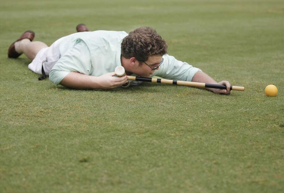 Unorthodox approach: Psst. Bowling Green High School senior Will Jenkins cheats at croquet. Pass it on. (Covington Woods Park in Bowling 