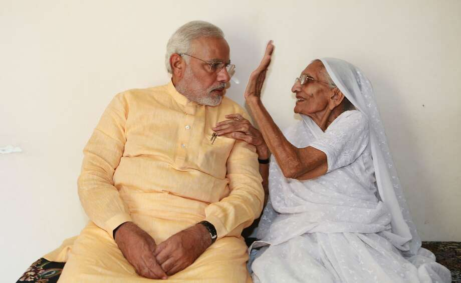 Don't make me slap you, young man:India's prime minister-elect Narendra Modi confers with his toughest critic - and biggest supporter -   his mother, Hira Ba, at her home in Gandhinagar. Photo: Gujarat Information Bureau, AFP/Getty Images