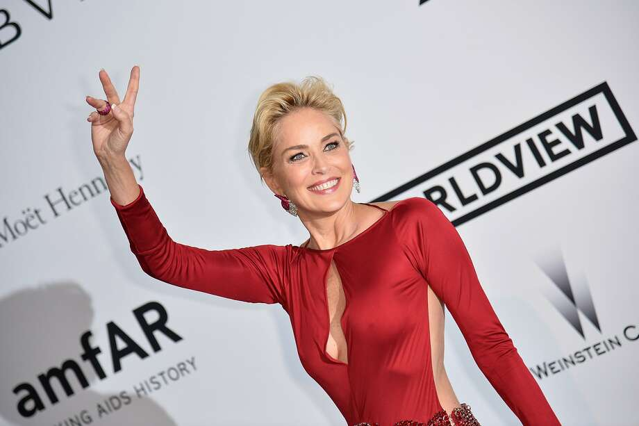 A 56-year-old lady makes an entrance at Cannes: When that lady is Sharon Stone, arriving for the amfAR 21st 