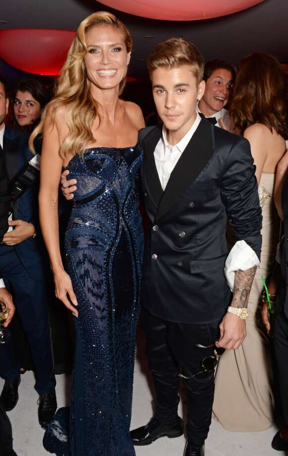 Heidi Klum (L) and Justin Bieber attend amfAR's 21st Cinema Against AIDS Gala after party. Photo: Dave M. Benett/amfAR14, WireImage