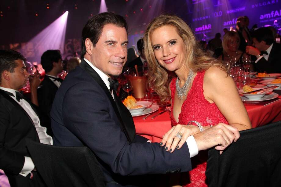 John Travolta and Kelly Preston attend amfAR's 21st Cinema Against AIDS Gala. Photo: Gisela Schober, German Select For Mercedes-Benz