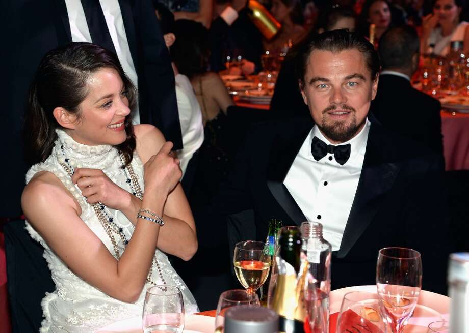 Leonardo DiCaprio and Marion Cotillard attend amfAR's 21st Cinema Against AIDS Gala. Photo: Pascal Le Segretain/amfAR14, WireImage
