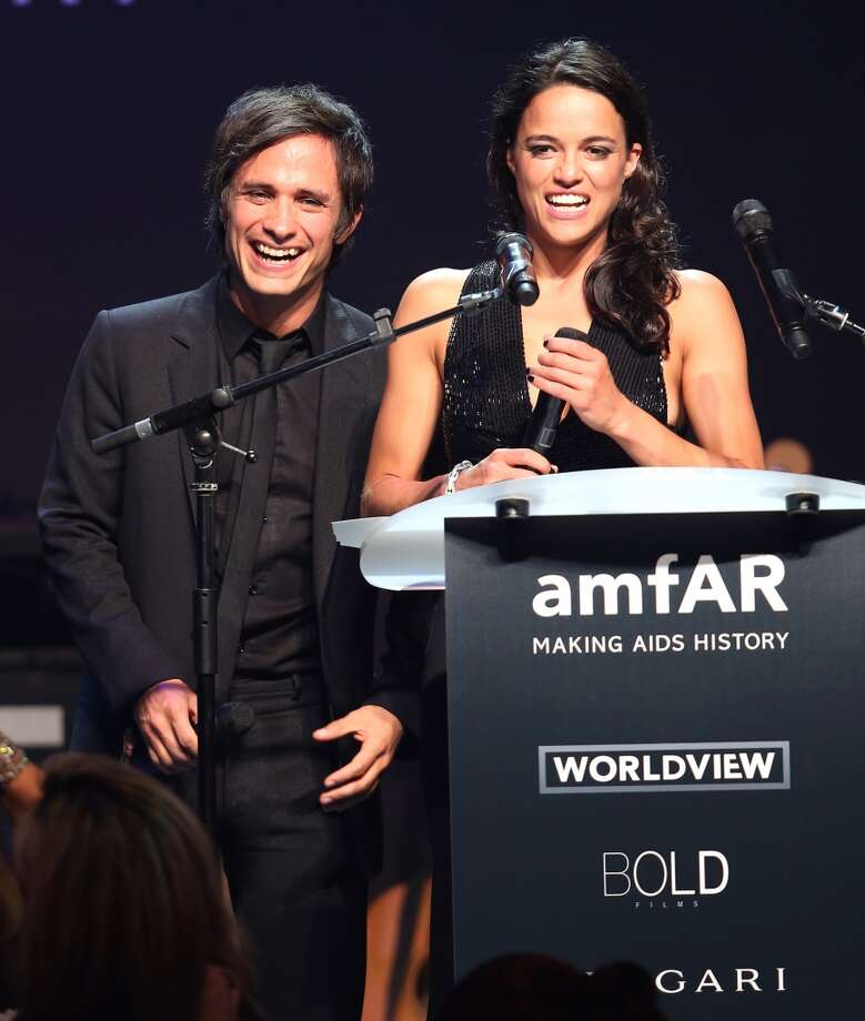 Gael Garcia Bernal and Michelle Rodriguez speak onstage during amfAR's 21st Cinema Against AIDS Gala. Photo: Tim P. Whitby, Getty Images For AmfAR