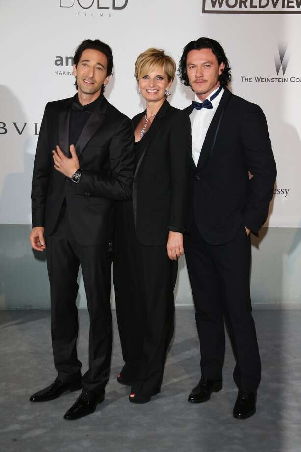 (L-R) Adrian Brody, Melita Toscan Du Plantier and Luke Evans attend amfAR's 21st Cinema Against AIDS Gala. Photo: Vittorio Zunino Celotto, Getty Images